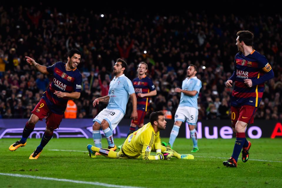 BARCELONA, SPAIN - FEBRUARY 14:  (L-R) Luis Suarez of FC Barcelona celebrates with his team mate Lionel Messi of FC Barcelona after scoring his team's fourth goal from the penalty spot during the La Liga match between FC Barcelona and Celta Vigo at Camp Nou on February 14, 2016 in Barcelona, Spain. Messi took the penalty, tapping the ball softly forward for Suarez to run up and score. (Photo by David Ramos/Getty Images)