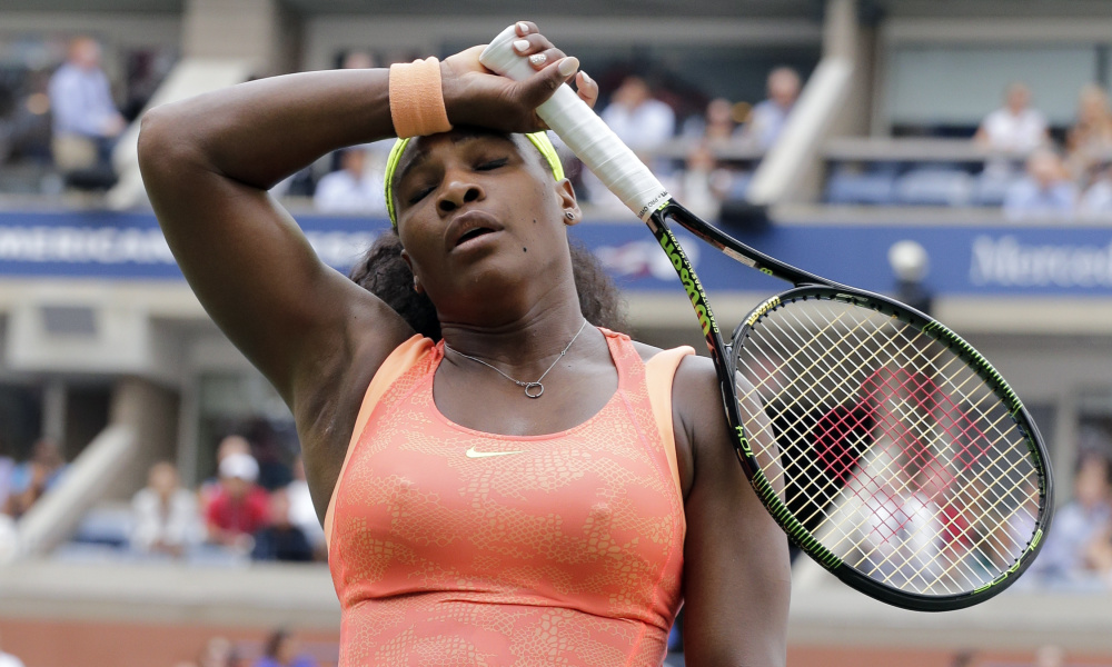 Serena Williams reacts after losing a point to Roberta Vinci, of Italy, during a semifinal match at the U.S. Open tennis tournament, Friday, Sept. 11, 2015, in New York. (AP Photo/Bill Kostroun) ORG XMIT: USO256